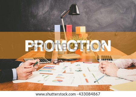 Two Businessman Promotion working in an office - stock photo