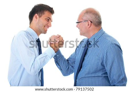 two businessman seal deal, agreement, senior one and younger one, both wear blue shirts and ties, welcome friendly handshake, isolated on white - stock photo