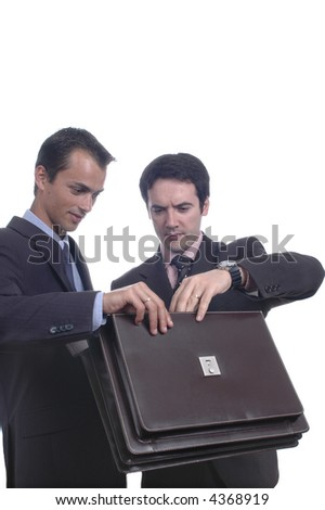 two businessman, they look something of a folder inside... - stock photo