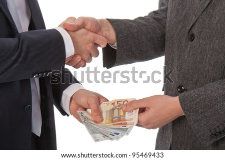 Two businessmen and paying money; isolated on white - stock photo