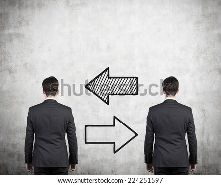 Two businessmen and two arrows 'left or right'. A concept of recruitment business.  - stock photo