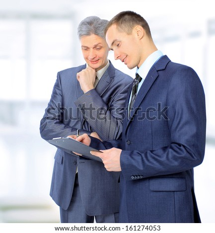Two businessmen conclude a deal. - stock photo
