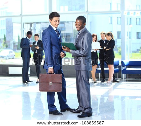 Two businessmen discussing - Isolated studio picture in high resolution. - stock photo