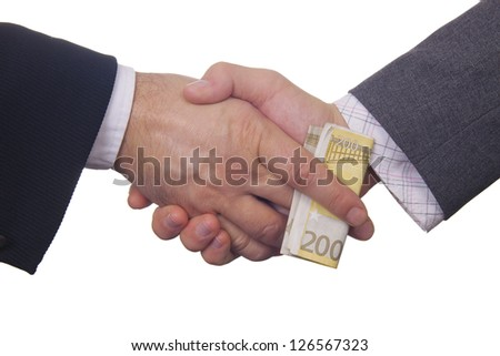 Two businessmen exchanging 200 hundred euros banknote bribing money - stock photo