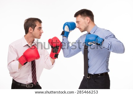 Two businessmen fighting for contract signing. Men in boxing-gloves isolated on white background. - stock photo