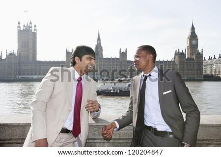 Two businessmen having a conversation - stock photo