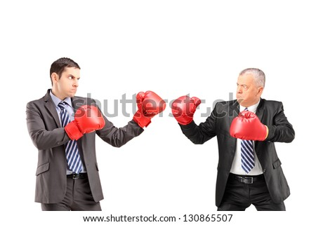 Two businessmen having a fight with boxing gloves, isolated on white background - stock photo