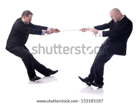 two businessmen in a tug of war isolated on white background - stock photo