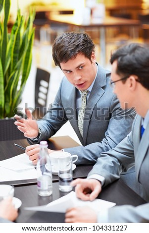 Two businessmen in an office - stock photo