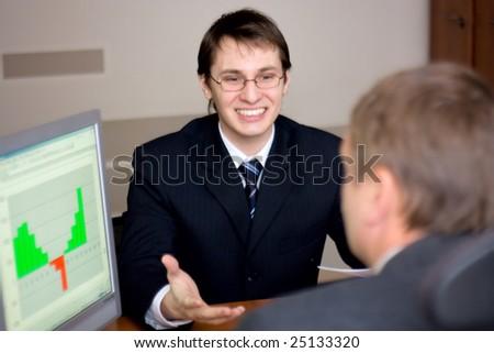 two businessmen in office talking - stock photo