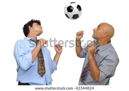 Two businessmen playing with a soccer ball  isolated in white - stock photo