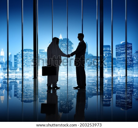 Two businessmen shaking hand in the office building. - stock photo