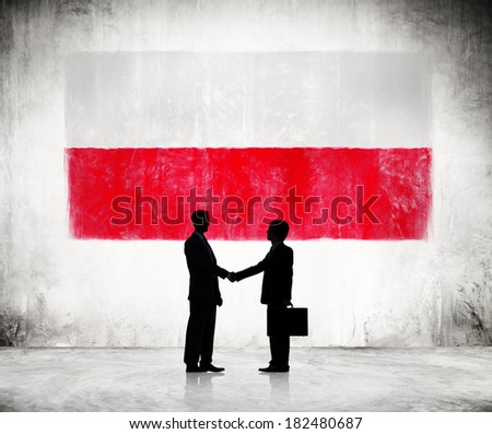 Two Businessmen Shaking Hands With Flag of Poland - stock photo