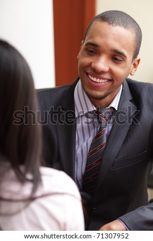 Two businesspartners having a conversation and laughing - stock photo