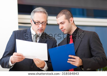 Two businesspeople discussing - stock photo