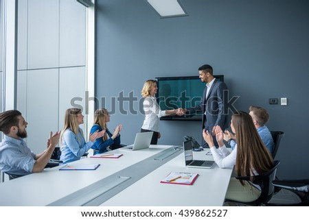 Two businesspeople handshaking on a business meeting. - stock photo
