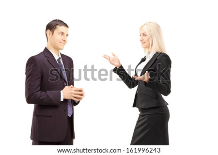 Two businesspeople having conversation together isolated on white background - stock photo