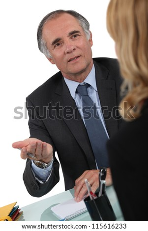 Two businesspeople having discussion - stock photo