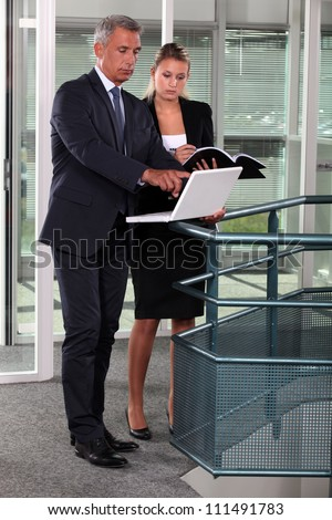 Two businesspeople in the hallway - stock photo