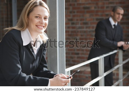 Two Businesspeople Text Messaging - stock photo