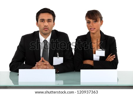Two businesspeople wearing visitor badges - stock photo