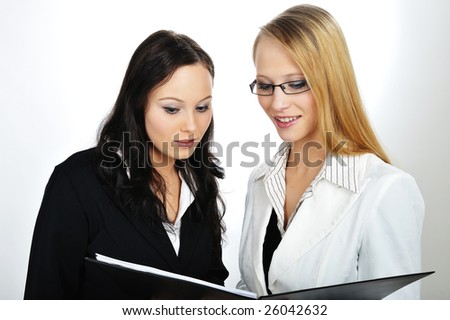 Two Businesswoman Discussion about work - stock photo