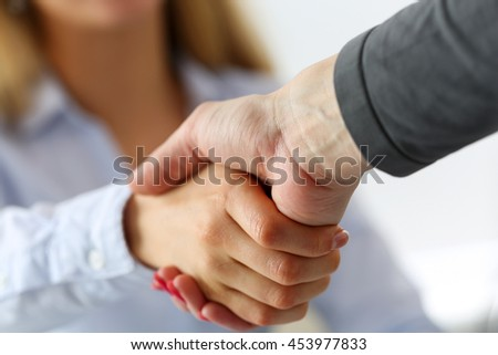 Two businesswoman shake hands as hello in office closeup. Friend welcome, introduction, greet or thanks gesture, product advertisement, partnership approval, arm, strike a bargain on deal concept - stock photo