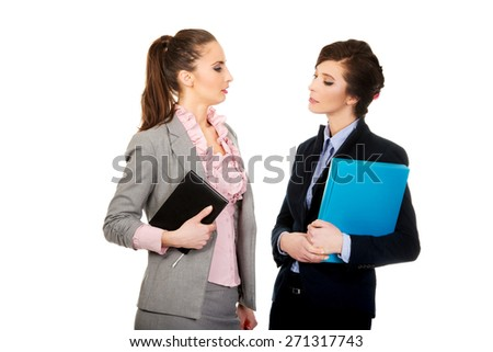 Two businesswomans with their notes. - stock photo