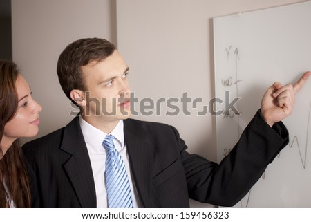 Two Businesswomen discussing about diagram  - stock photo