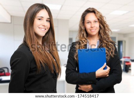 Two businesswomen in an office  - stock photo