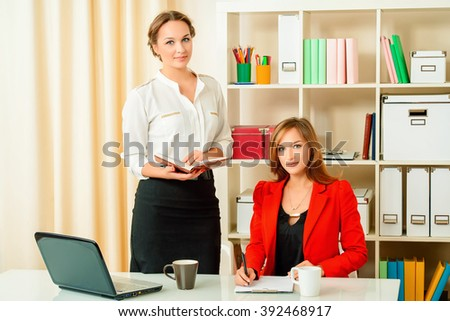 Two businesswomen interacting at meeting in the modern office. Business concept. Partnership. - stock photo