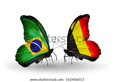 Two butterflies with flags on wings as symbol of relations Brazil and Belgium - stock photo