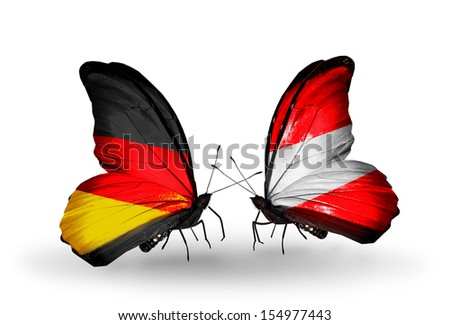 Two butterflies with flags on wings as symbol of relations Germany and Austria - stock photo