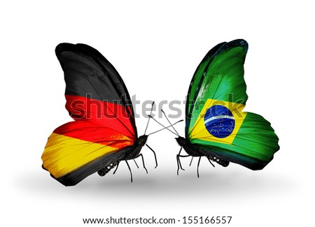 Two butterflies with flags on wings as symbol of relations Germany and Brazil - stock photo