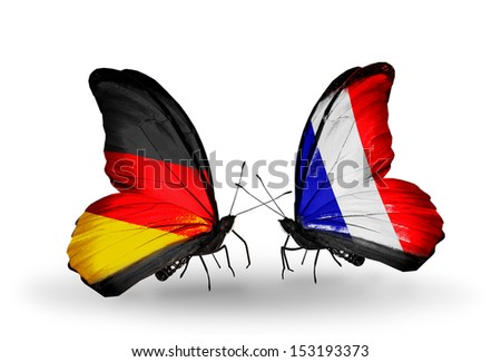 Two butterflies with flags on wings as symbol of relations Germany and France - stock photo