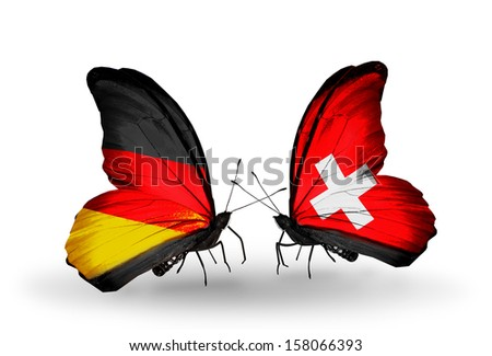 Two butterflies with flags on wings as symbol of relations Germany and Switzerland - stock photo