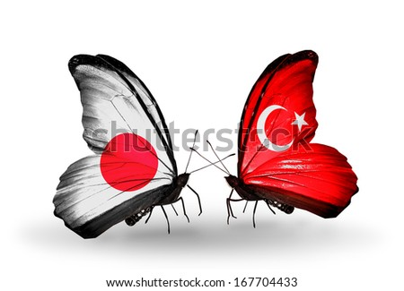 Two butterflies with flags on wings as symbol of relations Japan and Turkey - stock photo