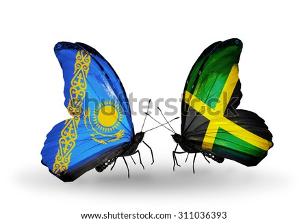 Two butterflies with flags on wings as symbol of relations Kazakhstan and Jamaica - stock photo
