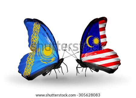Two butterflies with flags on wings as symbol of relations Kazakhstan and Malaysia - stock photo