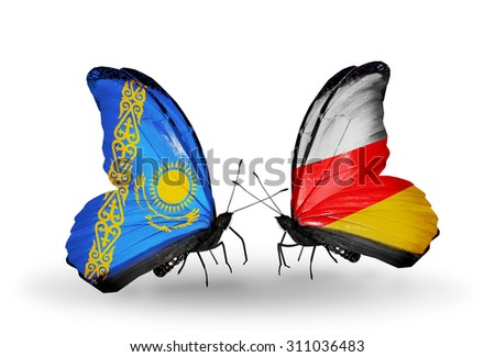 Two butterflies with flags on wings as symbol of relations Kazakhstan and Ossetia - stock photo