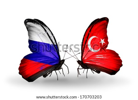 Two butterflies with flags on wings as symbol of relations Russia and  Turkey - stock photo