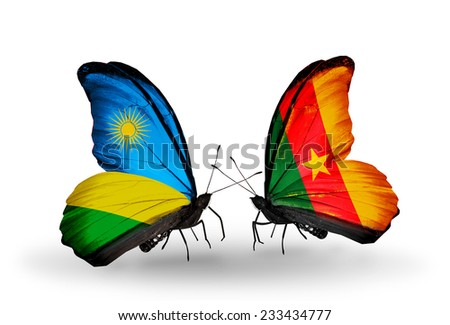 Two butterflies with flags on wings as symbol of relations Rwanda and Cameroon - stock photo