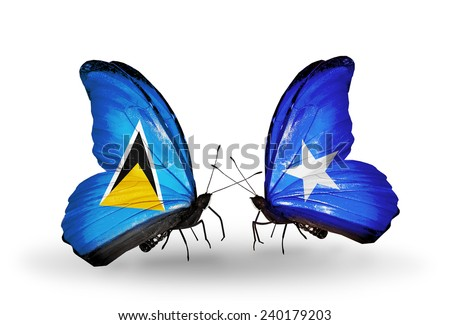 Two butterflies with flags on wings as symbol of relations Saint Lucia and Somalia - stock photo