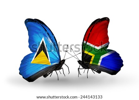 Two butterflies with flags on wings as symbol of relations Saint Lucia and South Africa - stock photo