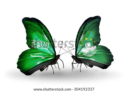 Two butterflies with flags on wings as symbol of relations Saudi Arabia and Macau - stock photo