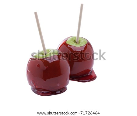 Two Candied Granny Smith apples isolated on white - stock photo