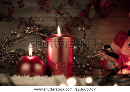 Two candles decorated in a festive Christmas decoration. - stock photo