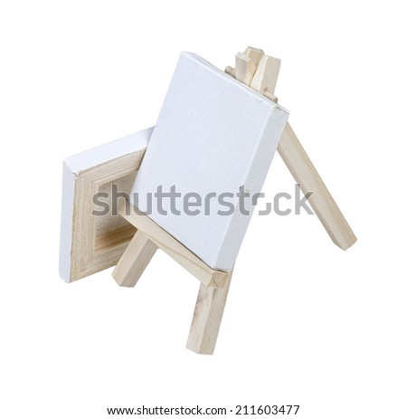 Two canvases on an easel used to hold artwork or painting - path included - stock photo