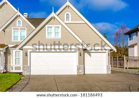 Two-car garage of a luxury house against blue sky in Vancouver, Canada - stock photo