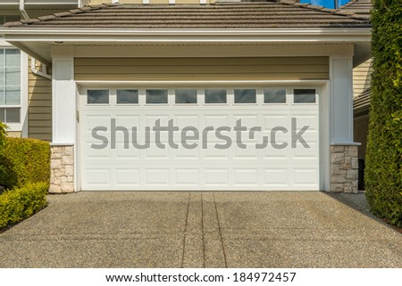 two-car garage on a sunny day in Vancouver, Canada - stock photo